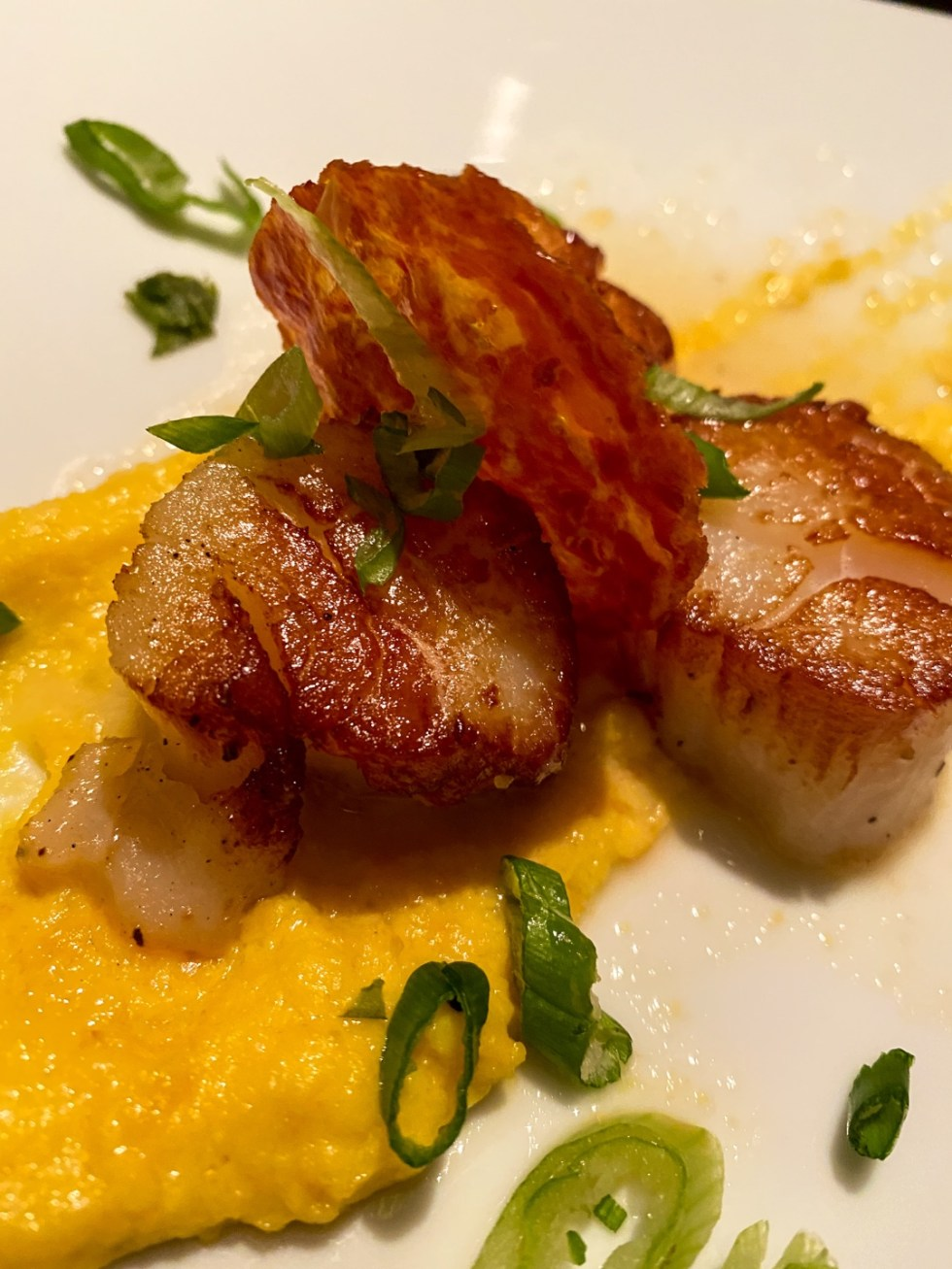 Weekend Travel: The Best Things to Do in Beaufort NC in 48 Hours - I'm Fixin' To - @imfixintoblog |Things to Do in Beaufort NC by popular NC travel blog, I'm Fixin' To: image of a plate of scallops.