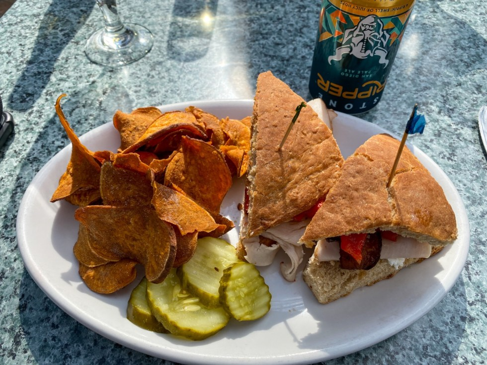 Weekend Travel: The Best Things to Do in Beaufort NC in 48 Hours - I'm Fixin' To - @imfixintoblog |Things to Do in Beaufort NC by popular NC travel blog, I'm Fixin' To: image of a turkey club sandwich and sweet potato chips.