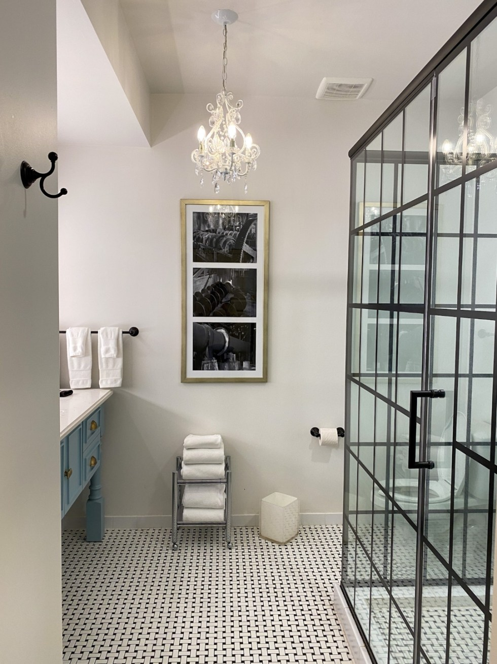 Weekend Travel: The Best Things to Do in Beaufort NC in 48 Hours - I'm Fixin' To - @imfixintoblog |Things to Do in Beaufort NC by popular NC travel blog, I'm Fixin' To: image of a bathroom with black and white tile and blue vanity and walk-in shower.