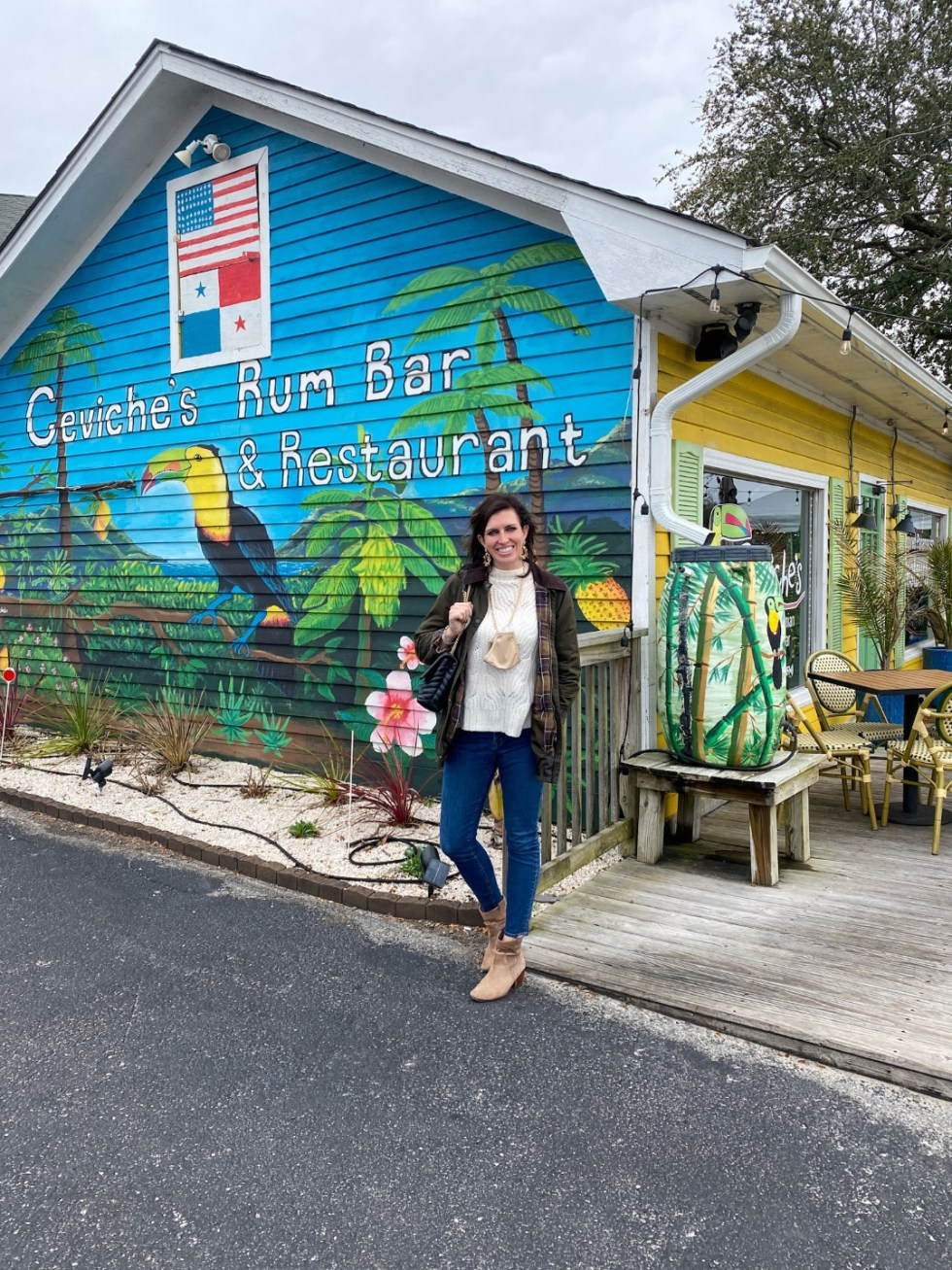 A Spring Weekend in Wilmington, NC: the Best Things to Do - I'm Fixin' To - @imfixintoblog |Weekend in Wilmington by popular NC travel blog, I'm Fixin' To: image of a woman standing in front of Ceviche's Rum Bar and Restaurant.