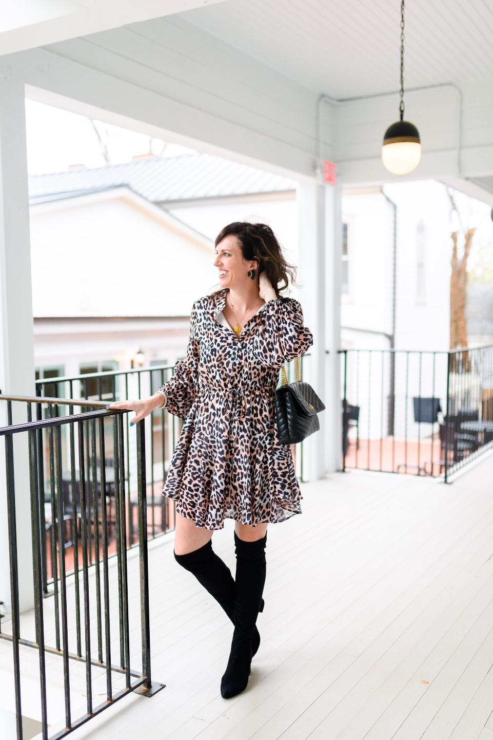 Places to Stay: The Colonial Inn in Hillsborough NC - I'm Fixin' To - @imfixintoblog |The Colonial Inn Hillsborough NC by popular NC travel blog, I'm Fixin' To: image of a woman wearing a leopard print dress and black over the knee boots.
