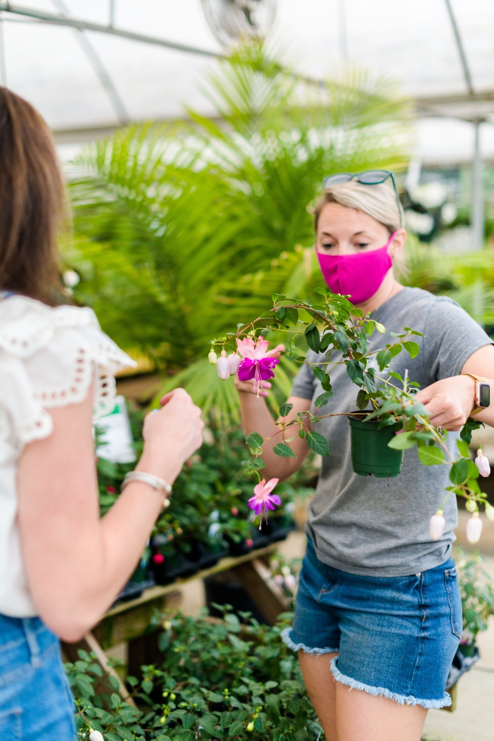 5 Spring Planting Tips with Fairview Garden Center - I'm Fixin' To - @imfixintoblog |Best Plants to Plant in Spring by popular NC lifestyle blog: image of two women looking at a pink floral plant at the Fairview Garden Center.