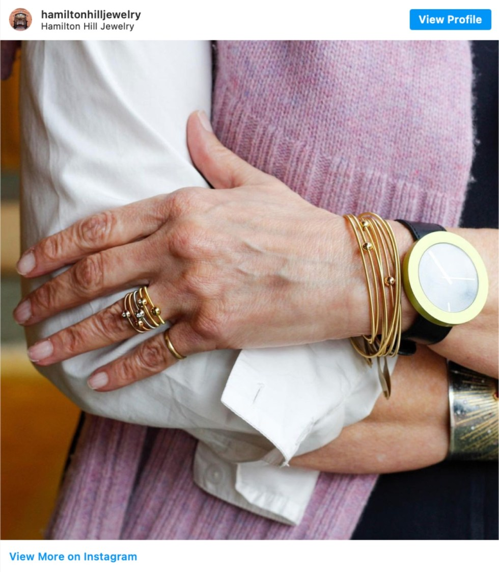 Durham Shopping: Top 11 Best Fashion Boutiques to visit After a Year of Quarantine - I'm Fixin' To - @imfixintoblog | Durham Shopping by popular NC lifestyle blog, I'm Fixin' To: image of a woman wearing gold bracelets and rings.