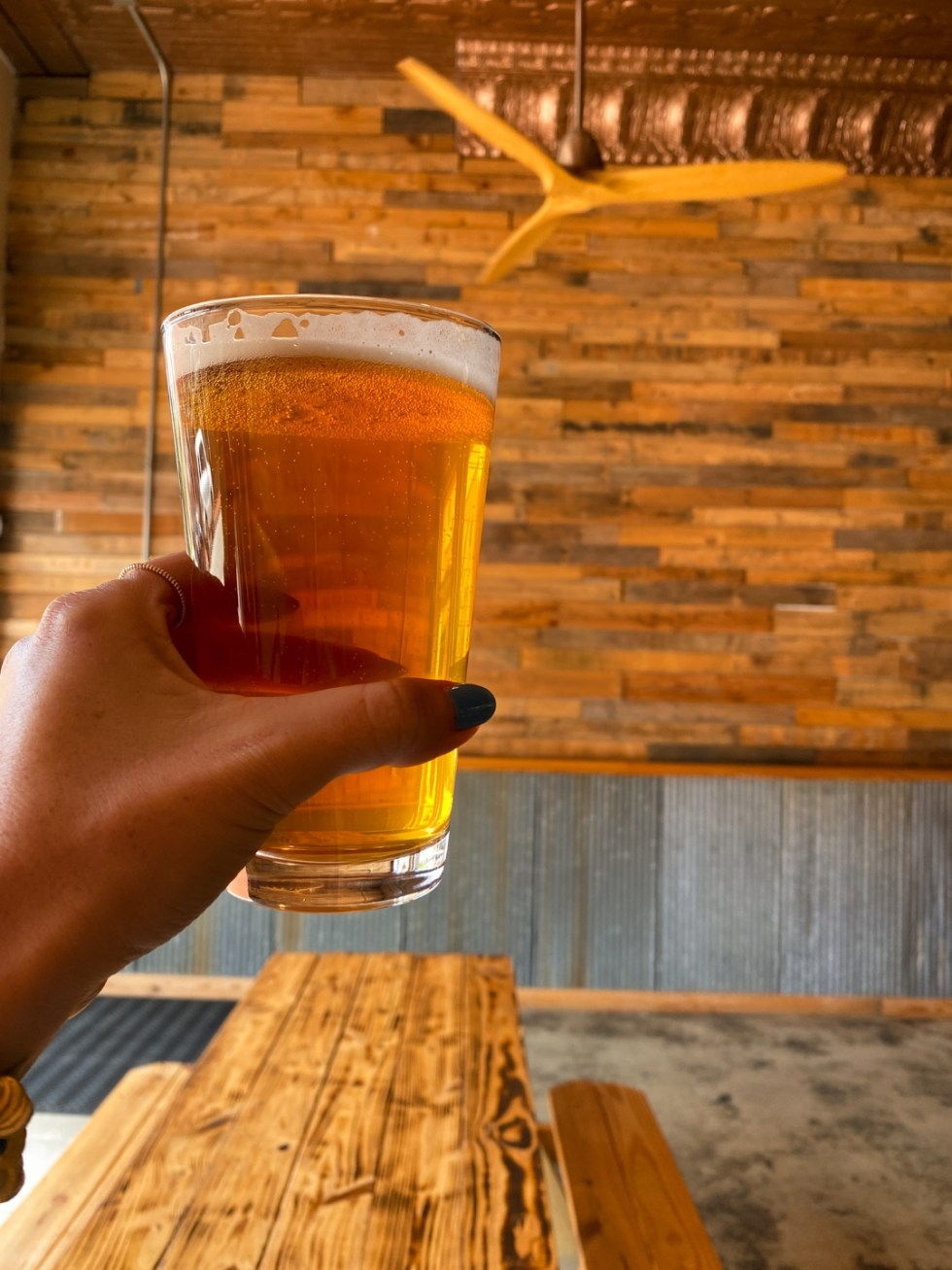 An Afternoon Trip to Franklin County, NC - I'm Fixin' To - @imfixintoblog | Franklin County NC by popular North Carolina travel blog, I'm Fixin' To: image of a woman holding a pint glass of beer.