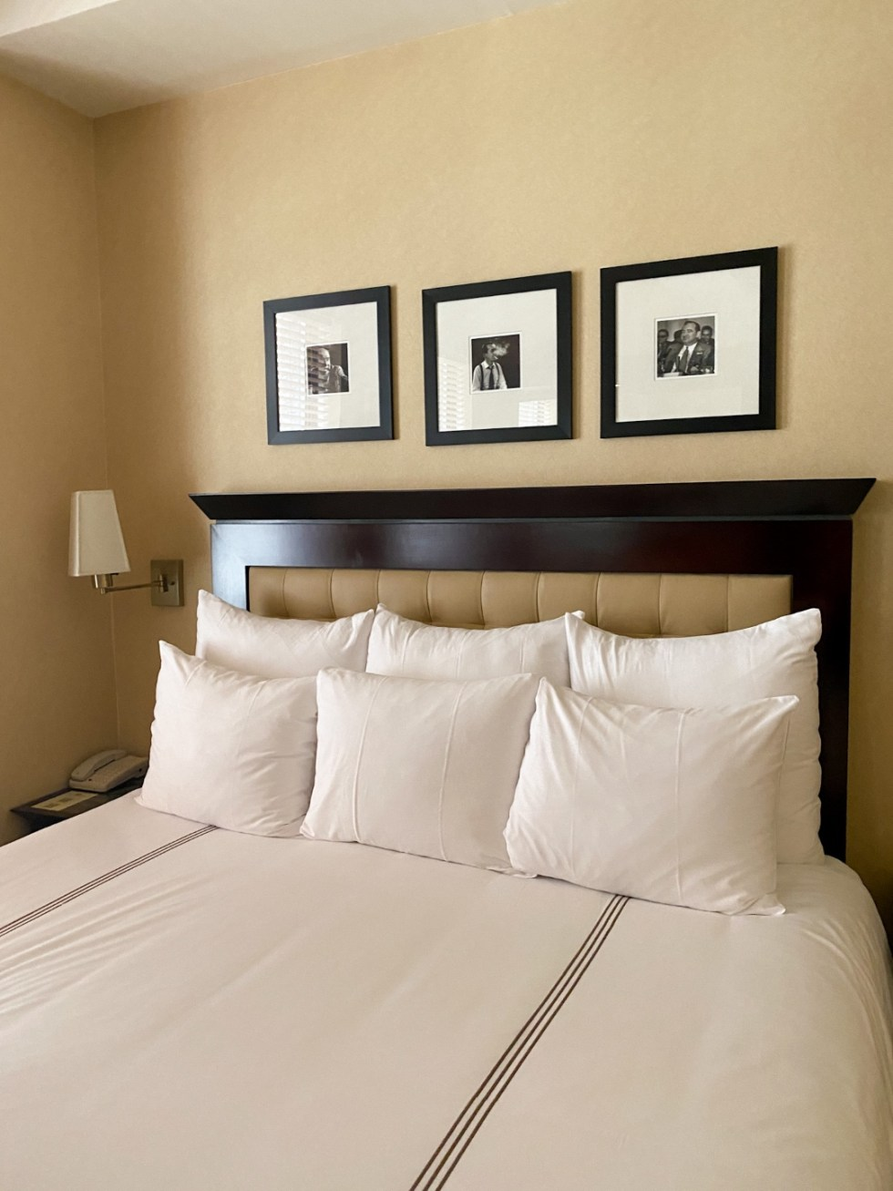 NYC Summer Weekend: Things to Do in NYC in the Summer - I'm Fixin' To - @imfixintoblog   NYC Summer Weekend by popular NC travel blog, I'm Fixin' To: image of a bed with black and white bedding.