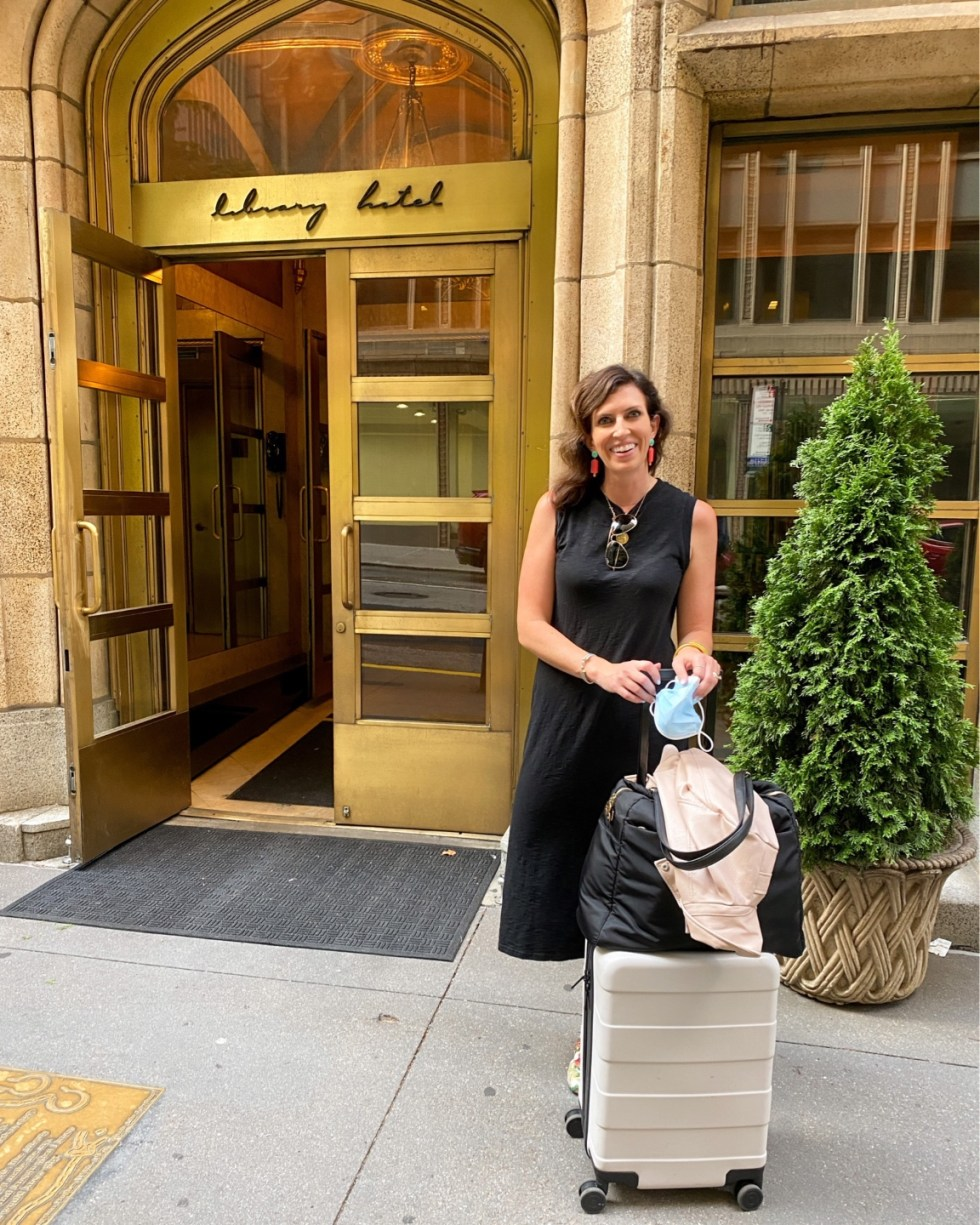 NYC Summer Weekend: Things to Do in NYC in the Summer - I'm Fixin' To - @imfixintoblog   NYC Summer Weekend by popular NC travel blog, I'm Fixin' To: image of a woman standing outside the library hotel.