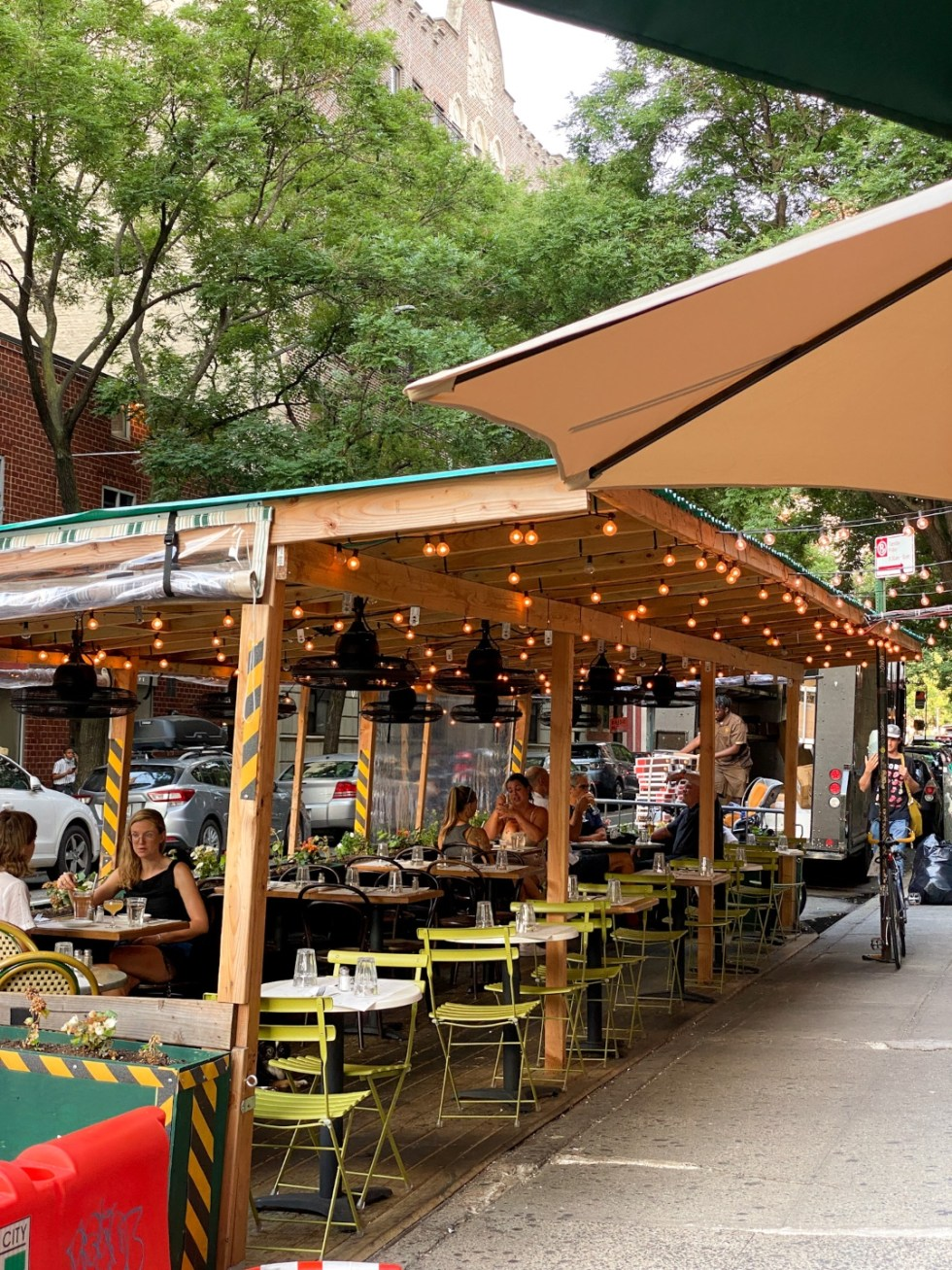 NYC Summer Weekend: Things to Do in NYC in the Summer - I'm Fixin' To - @imfixintoblog   NYC Summer Weekend by popular NC travel blog, I'm Fixin' To: image of Jack's Wife Freda restaurant outdoor eating area.