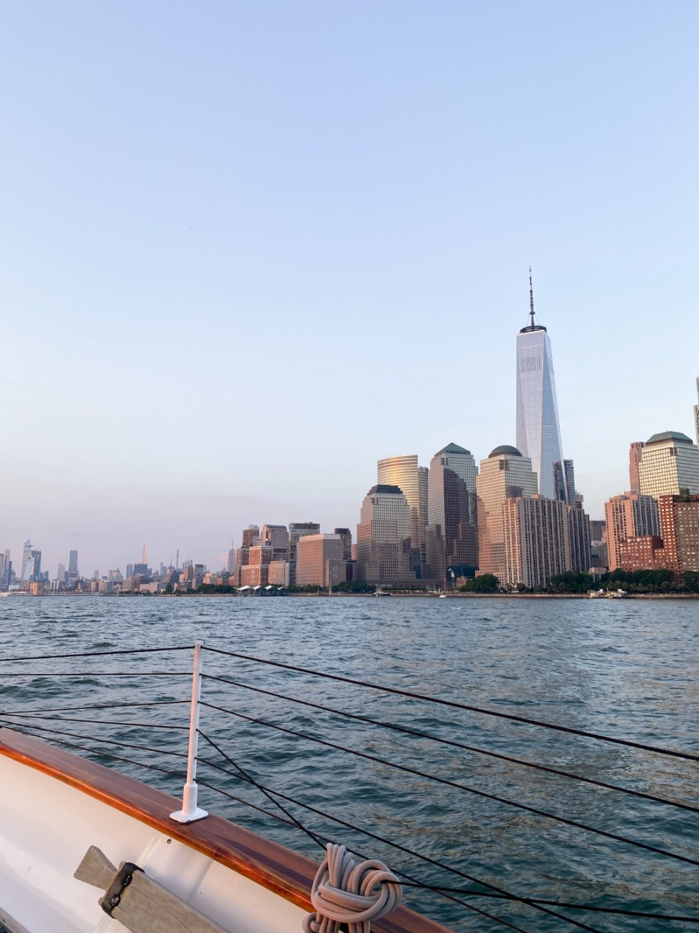 NYC Summer Weekend: Things to Do in NYC in the Summer - I'm Fixin' To - @imfixintoblog   NYC Summer Weekend by popular NC travel blog, I'm Fixin' To: image of a boat near the NYC skyline.