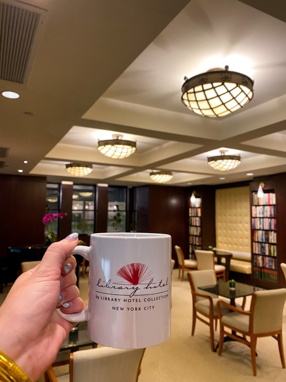 NYC Summer Weekend: Things to Do in NYC in the Summer - I'm Fixin' To - @imfixintoblog   NYC Summer Weekend by popular NC travel blog, I'm Fixin' To: image of a woman holding a library hotel mug.