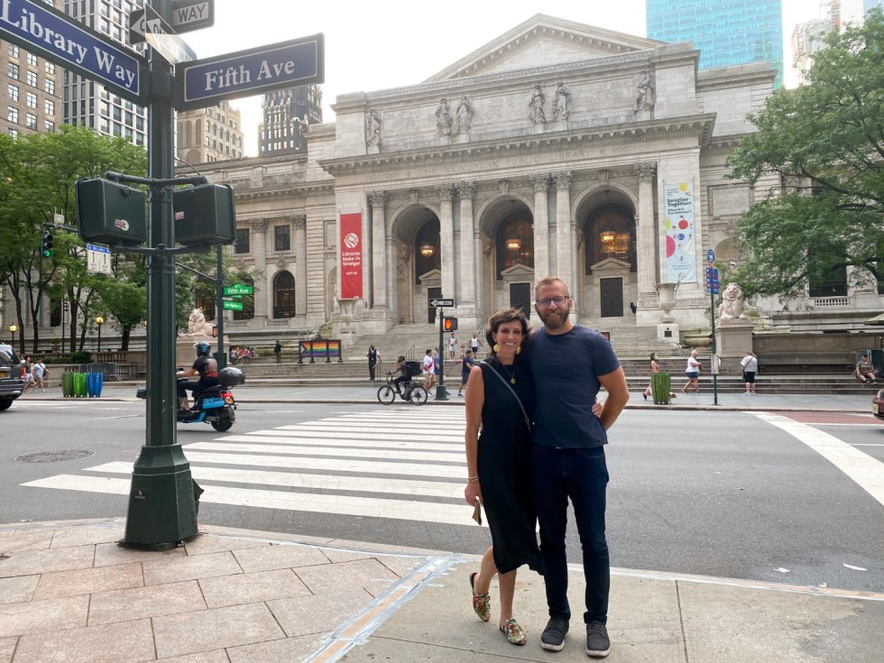 NYC Summer Weekend: Things to Do in NYC in the Summer - I'm Fixin' To - @imfixintoblog   NYC Summer Weekend by popular NC travel blog, I'm Fixin' To: image of a many and woman standing in front of the NYC library.