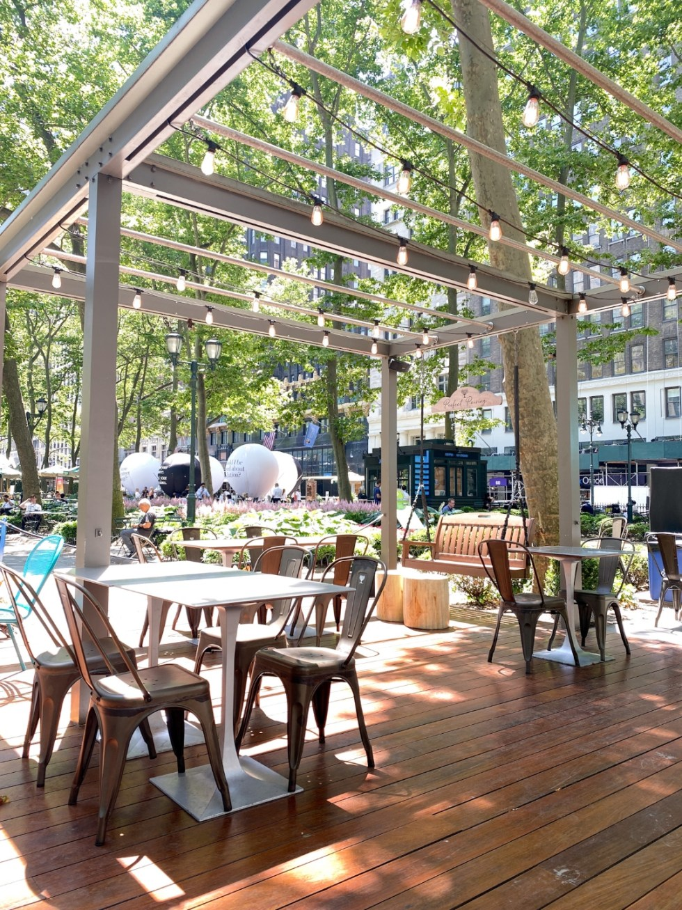 NYC Summer Weekend: Things to Do in NYC in the Summer - I'm Fixin' To - @imfixintoblog   NYC Summer Weekend by popular NC travel blog, I'm Fixin' To: image of Bryant Park cafe.