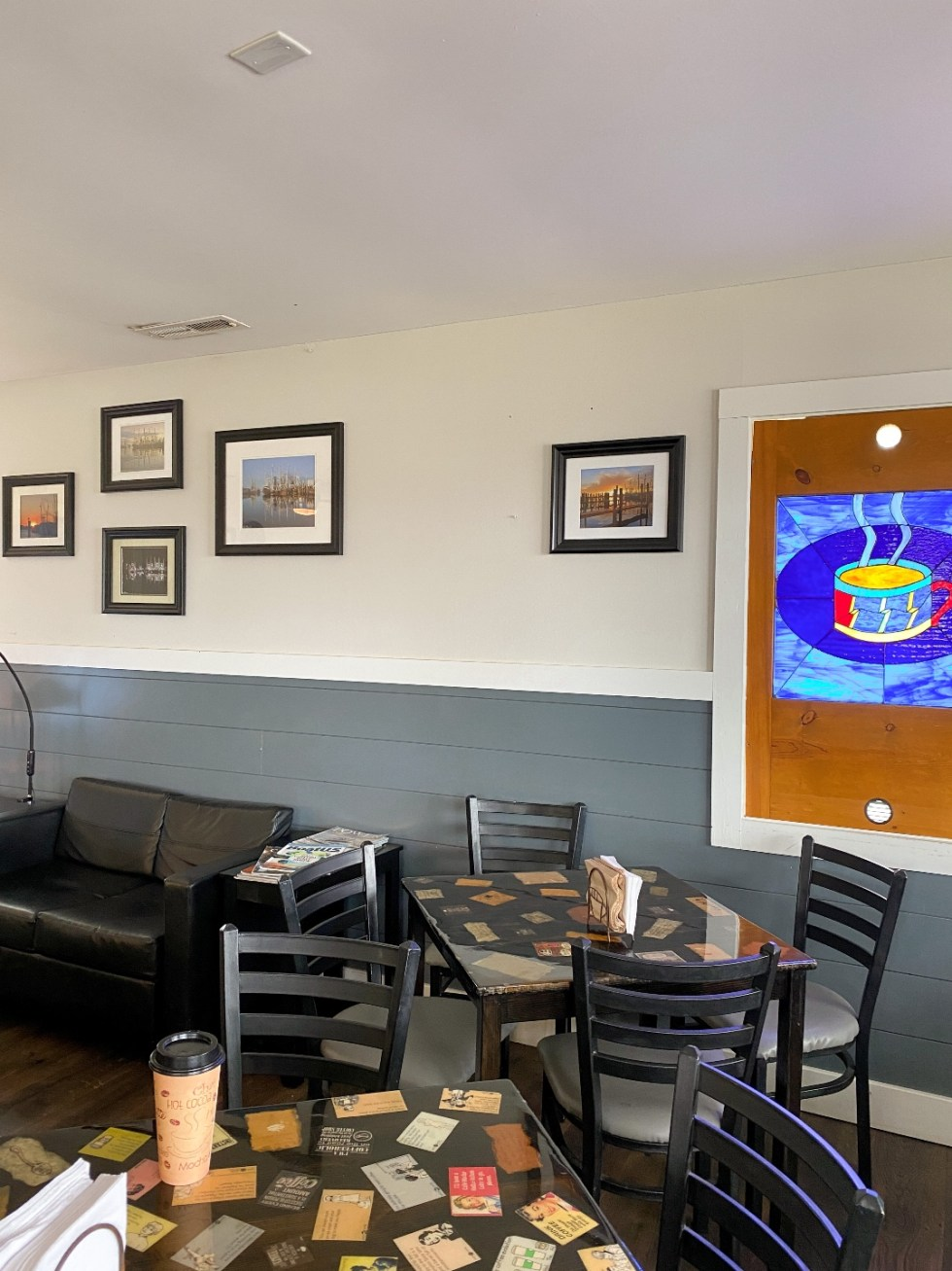 What to Do in Oriental, NC - I'm Fixin' To - @imfixintoblog | Things to do in Oriental NC by popular NC travel blog, I'm Fixin' To: image of some black table and chairs in a coffee and ice cream shop.