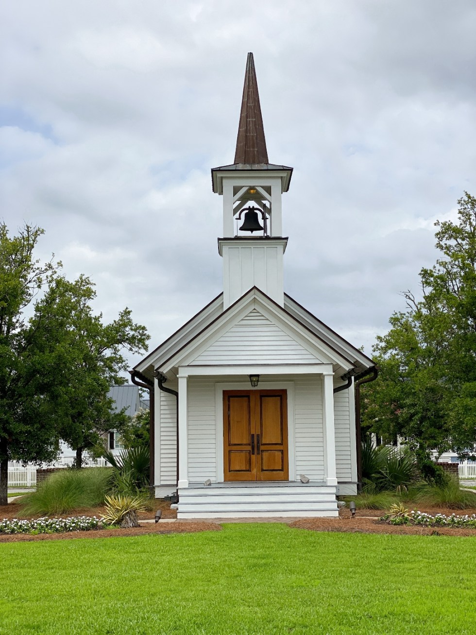 What to Do in Oriental, NC - I'm Fixin' To - @imfixintoblog | Things to do in Oriental NC by popular NC travel blog, I'm Fixin' To: image of a white church with a bell tower and double wood doors.