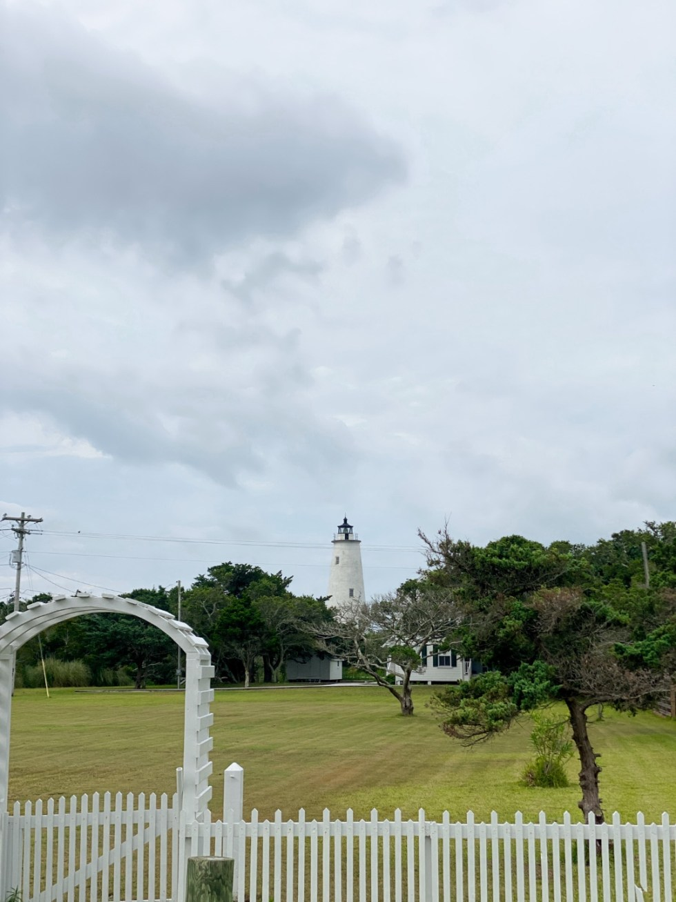 An Update on My North Carolina 100 County Tour - I'm Fixin' To - @imfixintoblog | Things to do in North Carolina by popular NC travel blog, I'm Fixin' To: image of a white lighthouse.