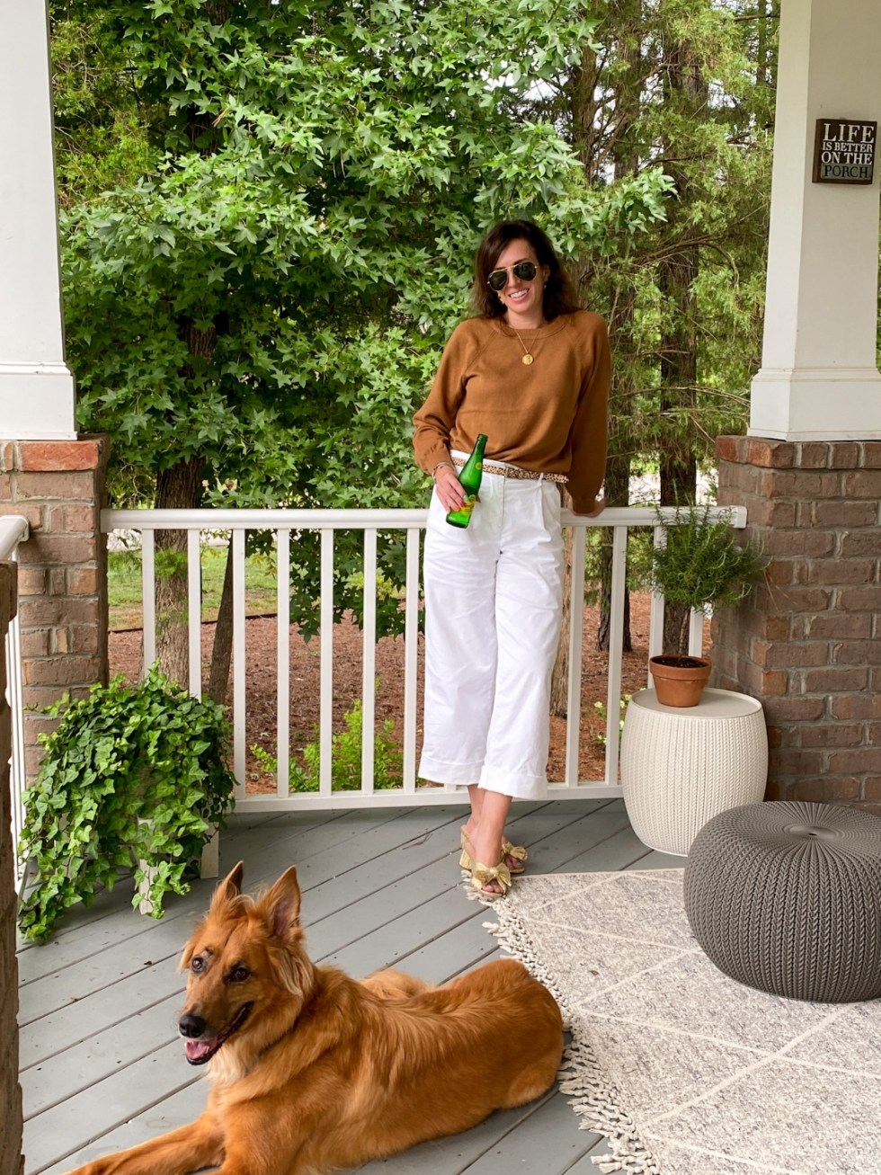 How to Wear White After Labor Day - I'm Fixin' To - @imfixintoblog   White After Labor Day by popular NC fashion blog, I'm Fixin' To: image of a woman wearing a brown sweater with white cropped pants and gold bow accent sandals.