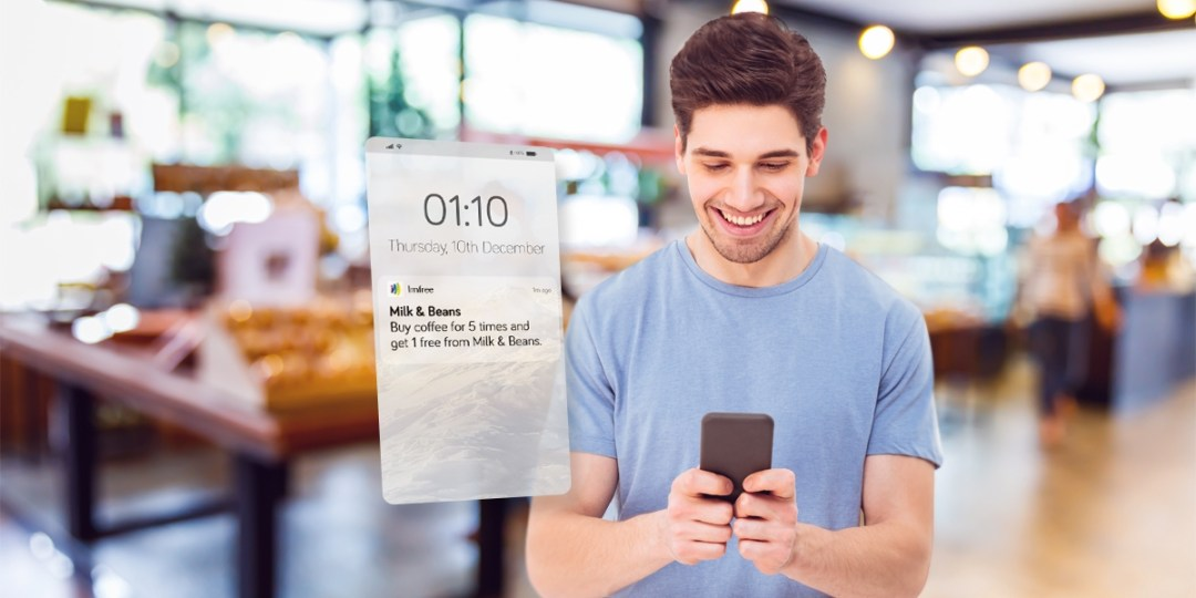 man receives a notification from a bakery through her loyalty rewards app