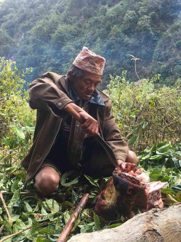 Elderly Man Butchering Meat in Nepal