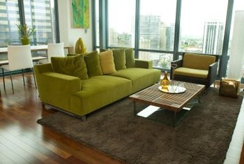 living room design tips cheap leather sofa sets on rearranging a small home guides sf gate use an area rug to define and anchor the furniture arrangement in