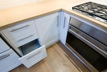 sliding drawers for kitchen cabinets copper sink replacement drawer slides latest car release date how to replace cabinet home guides sf gate
