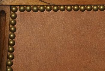 black leather sofa with nailheads office designs how to decorate mixing brown furniture home guides often features nailhead trim