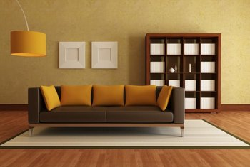 yellow and brown living room decorating ideas grey how to use paint with leather sofas home guides sf gate the orange almost umber pillows lampshade create a bridge between this muted wall