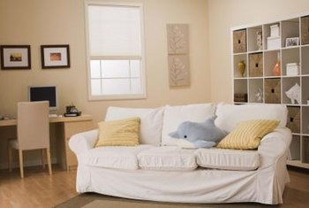 sofa sheets futura leather jordans how to re cover a with home guides sf gate little creative tucking no one will ever know your slipcover is sheet