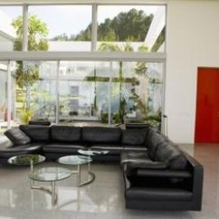 Living Rooms With Black Leather Sofas Outdoor Room Ideas How To Paint A That Has Couch Home Guides Using Light Color On The Walls Around Your Sofa Softens Its Look