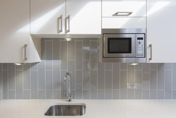gray tile kitchen floor fireclay sink what color cabinets go with home guides sf gate white enhance the neutrality of tiles