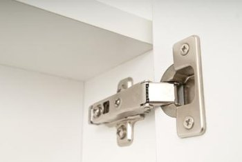 hinges for kitchen cabinets faucet single handle how to install hidden on home guides sf gate this concealed hinge is not visible when the cabinet closed