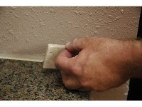 How to Install a Travertine Tile Backsplash (with Pictures