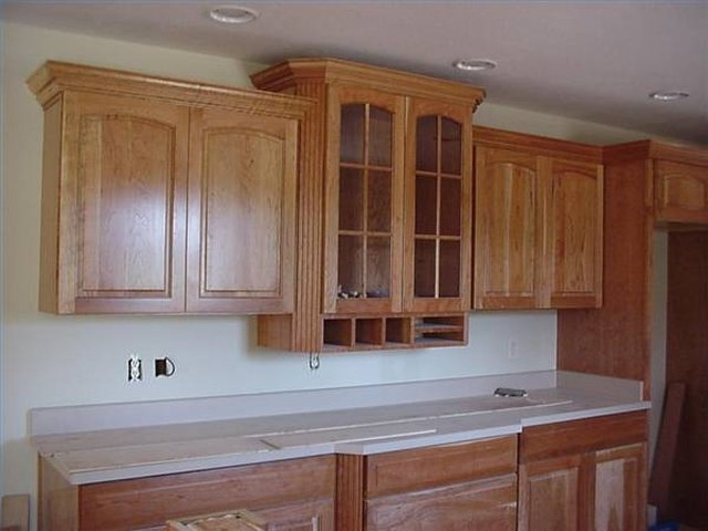 kitchen cabinet crown molding bell how to cut for cabinets ehow