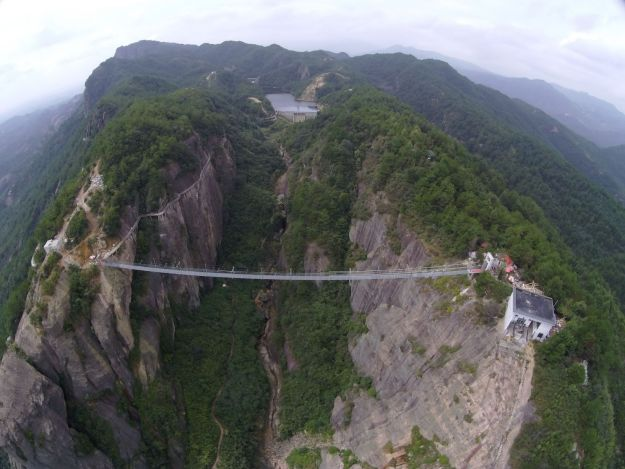 13 Pics Of A Glass Bridge That Strikes Fear In Tourists' Hearts 6