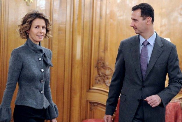 Syrian president Bashar al-Assad and his wife Asma arrive to deliver a speech for the Syrian Community on December 9, 2010 in Paris. Al-Assad is on a two-days official visit to France. AFP PHOTO MIGUEL MEDINA (Photo credit should read MIGUEL MEDINA/AFP/Getty Images)