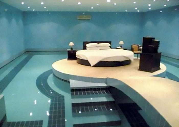 Bed in the middle of a swimming pool  | 10 Bizarre Beds You'd Never Be Able To Sleep In | Brain Berries
