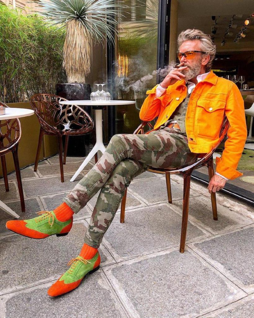 Pierrick makes work Bright orange jacket, tight camo pants, bright orange and green shoes  | 12 Classiest Yet Fun OOTD You've Ever Seen From Pierrick Mathon | Her Beauty