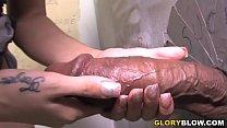 Big black cock slut Megan Foxx gives interracial blowjob at a public restroom.