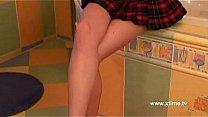 Brunette teenie masturbates her pussy in bathroom