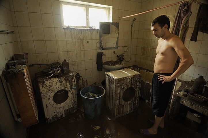 A local man inspects his flooded house in Krymsk