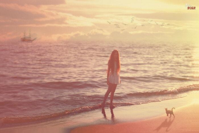 Девушка и кошка на побережье. Автор фотографии: G. BUER.
