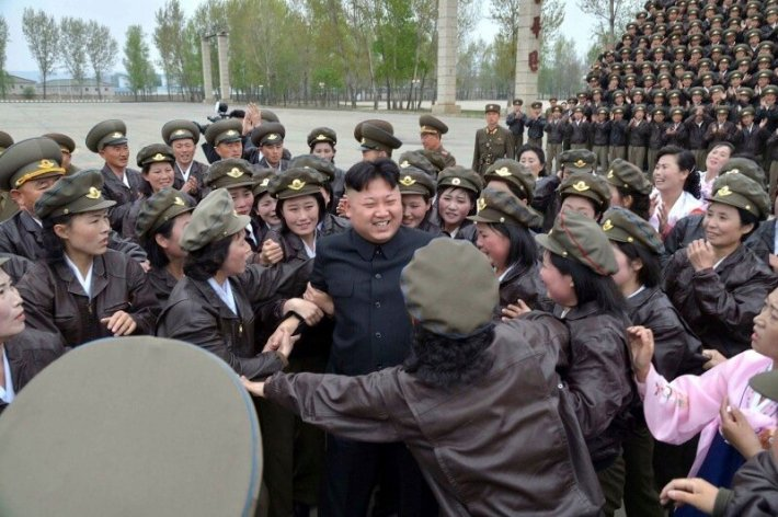 North Korean leader Kim Jong Un is surrounded by female participants of first meeting of airpersons of Korean People's Army during a photo-taking session in Pyongyang