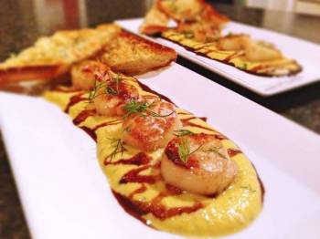 Sea scallops, tarragon butternut squash purée, honey balsamic reduction and truffled parmesan toast