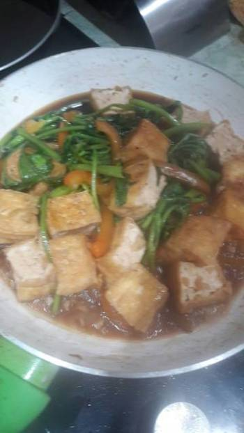 Stir fry Tofu and water spinach with oyster sauce
