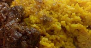 Indonesian Rendang And Yellow Rice