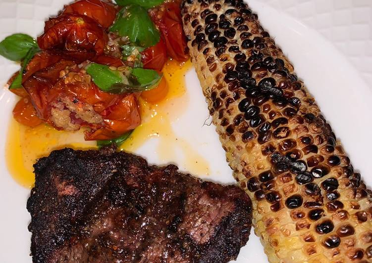 Grilled Fillet Mignon with grilled corn and roasted garlic tomatoes 🍅