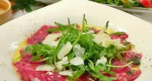 Beef Carpaccio With Arugula, Pesto Oil And Truffle Paste