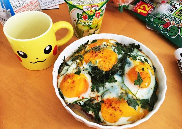 Baked eggs on seasonal greens and prosciutto