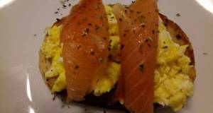 Smoked salmon and scrambled egg on toasted oregano bread