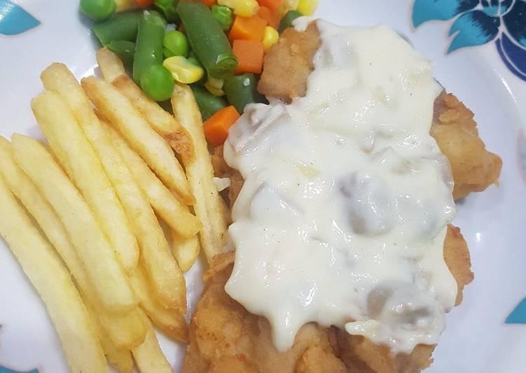 Crispy chicken steak with mushroom creamy sauce
