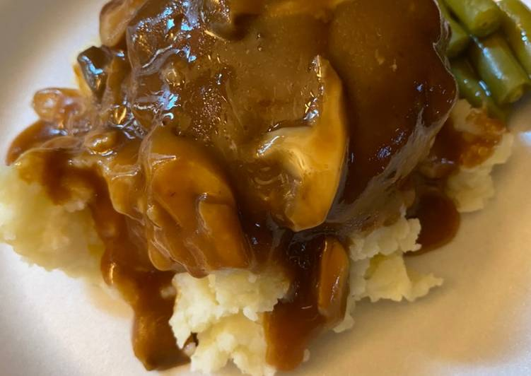 Simple Salisbury steaks over mashed potatoes