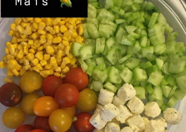 Salade concombre, tomate, maïs et boursin